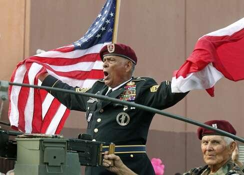 Sgt. Major Balderrama leads a veterans group down broadway during the Fiesta Flambeau Night Parade in downtown San Antonio  on April 26, 2014. Photo: Tom Reel, San Antonio Express-News