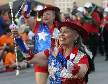 Performers with the San Antonio Marching Band strut down Broadway during the Fiesta Flambeau Night Parade in downtown San Antonio  on April 26, 2014. Photo: Tom Reel, San Antonio Express-News