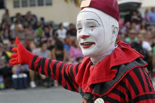 A clown waves to the crowd during the Fiesta Flambeau Night Parade in downtown San Antonio  on April 26, 2014. Photo: Tom Reel, San Antonio Express-News
