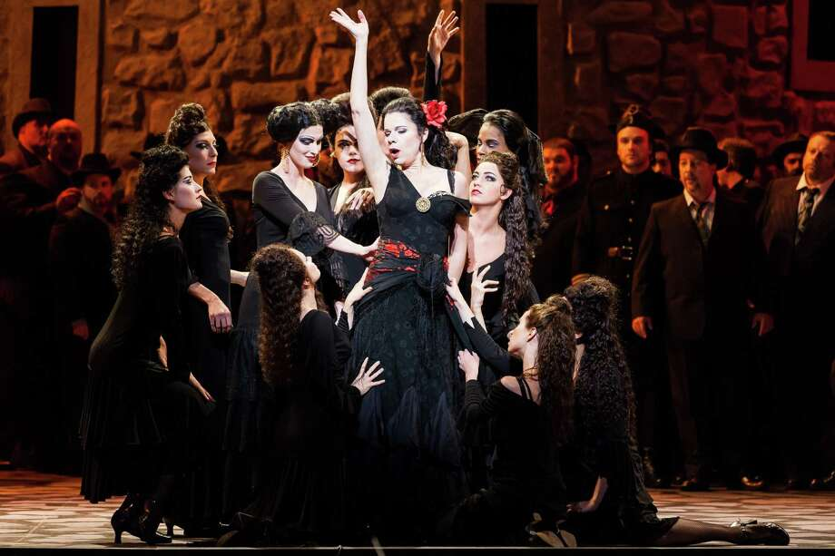 "Ana Maria Martinez, center, plays the title character in Georges Bizet's ""Carmen."" Photo: Lynn Lane / Lynn Lane"
