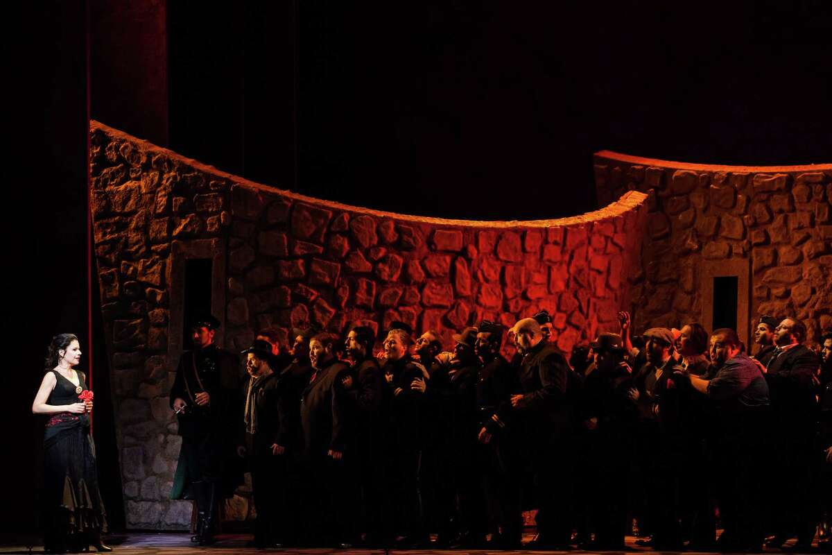 Ana Maria Martinez (left) plays Carmen in Houston Grand Opera's production of Georges Bizet's