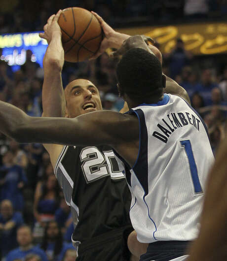 With less that two seconds left in the game, the Spurs' Manu Ginobili hit a shot over Mavericks center Samuel Dalembert that gave the Spurs a 108-106 lead in Game 3. It would not hold. Photo: Jerry Lara / San Antonio Express-News / ©2014 San Antonio Express-News