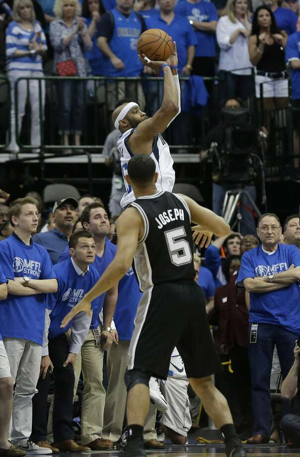 Cory Joseph watches Vince Carter shoot the game-winner. Photo: LM Otero, Associated Press