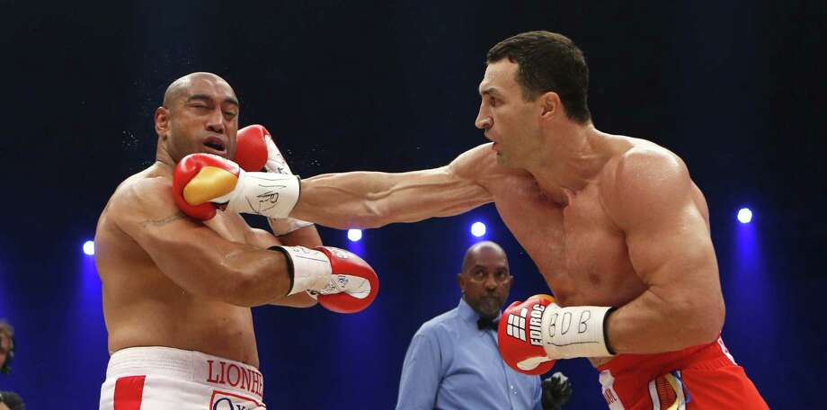 Heavyweight champion Wladimir Klitschko (right) connects to the jaw of Australian challenger Alex Leapai en route to a fifth-round knockout Saturday. Photo: Frank Augstein / Associated Press / AP