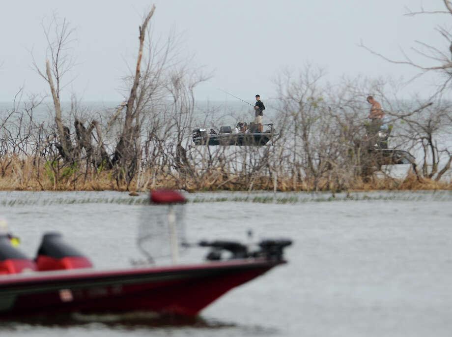 Anglers vie for fish on Lake Sam Rayburn. Photo taken Saturday, 4/26/14 Jake Daniels/@JakeD_in_SETX Photo: Jake Daniels / ©2014 The Beaumont Enterprise/Jake Daniels