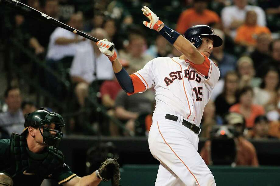 The Astros' Jason Castro hits an RBI single in the eighth inning, part of Houston's four-run outburst. Photo: Scott Halleran / Getty Images / 2014 Getty Images