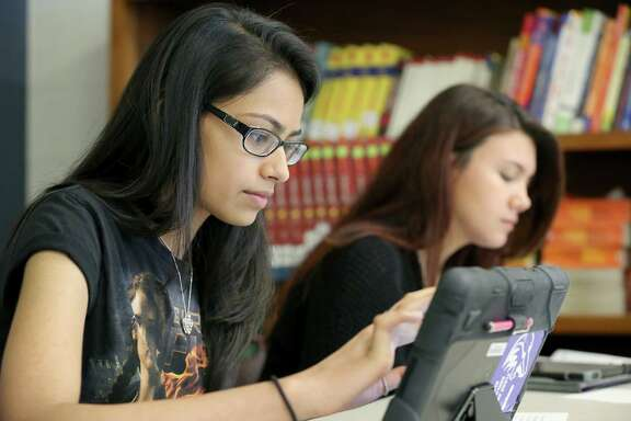 Meghan Bhakta, left, and Lindsey Gumbar work on a pre-Advanced Placement chemistry quiz at the Clear Horizons Early College High School, which shares a campus with San Jacinto College.