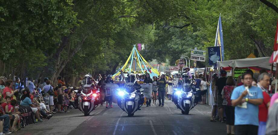 Motorcycle officers clear the way for the parade at King William Fair, the primary fundraiser for the King William Association, which boasts itself as the oldest historic district in Texas. Photo: Kin Man Hui, San Antonio Express-News / ©2014 San Antonio Express-News