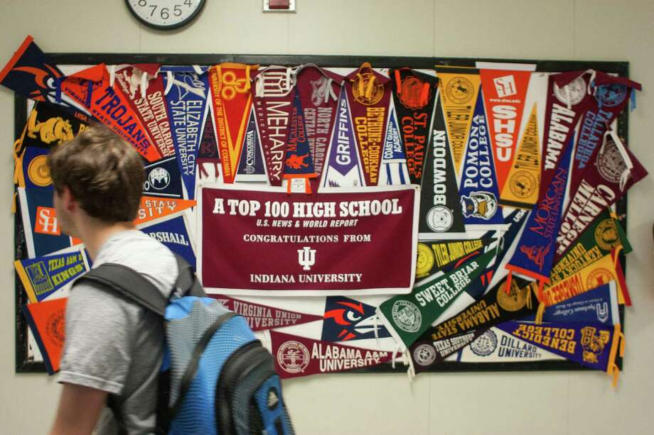College pennants line the hallway of the Michael E. DeBakey High School for Health Professions. The school is consistently listed as Houston's top high school as well as being recognized across the country. Photo: Johnny Hanson / © 2014  Houston Chronicle