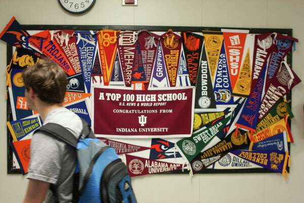 College pennants line the hallway of the Michael E. DeBakey High School for Health Professions. The school is consistently listed as Houston's top high school as well as being recognized across the country.