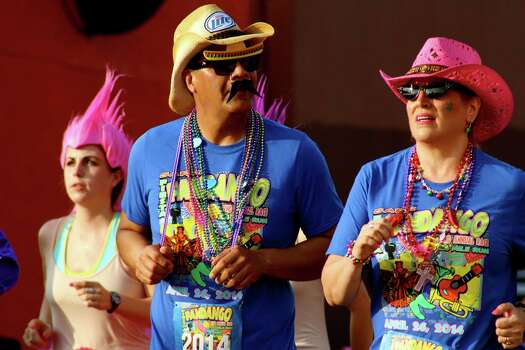 A look a the people who hit the streets for the 2014 Fiesta Flambeau Parade. Photo: By Yvonne Zamora, For MySA.com