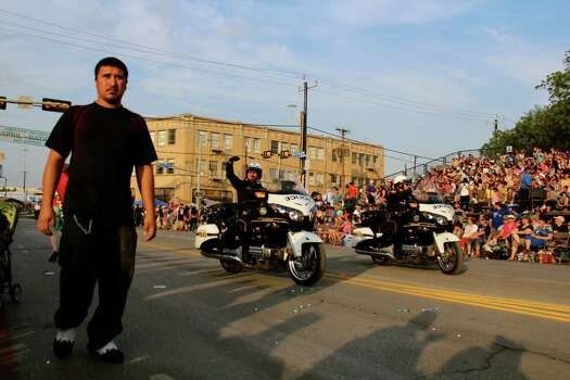 A look a the people who hit the streets for the 2014 Fiesta Flambeau Parade. Photo: By DeAnne Cuellar, For MySA.com