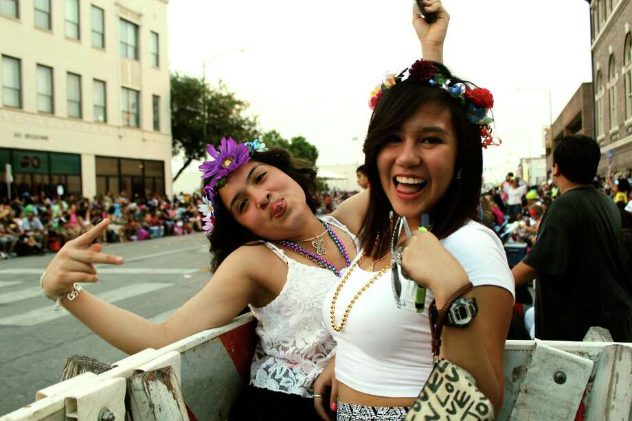 These ladies rocked flower crowns to prepare for the 2014 Fiesta Flambeau Parade in San Antonio.  Photo: By Yvonne Zamora,  For MySA.com