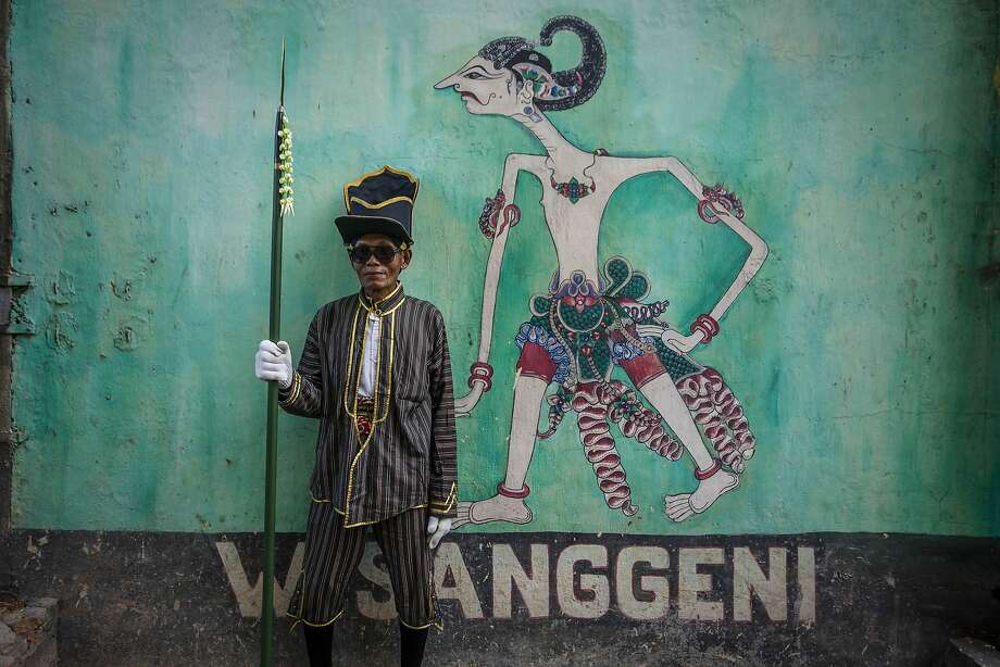 YOGYAKARTA, INDONESIA - APRIL 26:  A soldier of Kraton Palace poses during the Cembengan ritual 'Manten Tebu' on April 26, 2014 in Yogyakarta, Indonesia. The Cembengan ritual, performed to bring about a good season's sugarcane crop, is held annually before the milling and processing season starts in Indonesian Madukismo sugar mills. (Photo by Ulet Ifansasti/Getty Images) *** BESTPIX *** Photo: Ulet Ifansasti, Getty Images