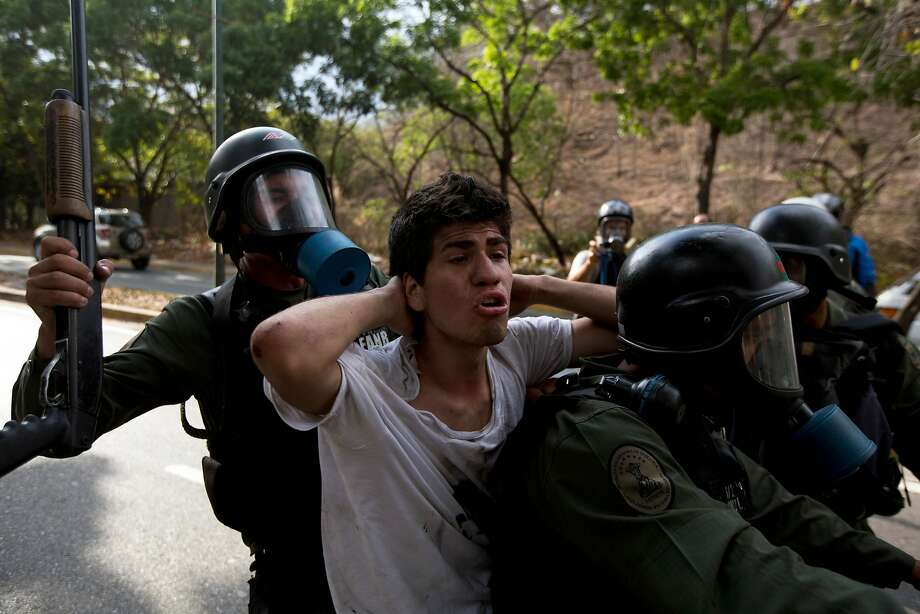 A n anti-government demonstrator is detained by Bolivarian national Guards during a protest in Caracas, Venezuela, Saturday, April 26, 2014. Student organizers at the last minute decided against marching downtown to avoid a confrontation with security forces in the government-controlled district. Instead they concentrated in the wealthier, eastern neighborhoods that have been the hotbed of unrest since February. (AP Photo/Fernando Llano) Photo: Fernando Llano, Associated Press