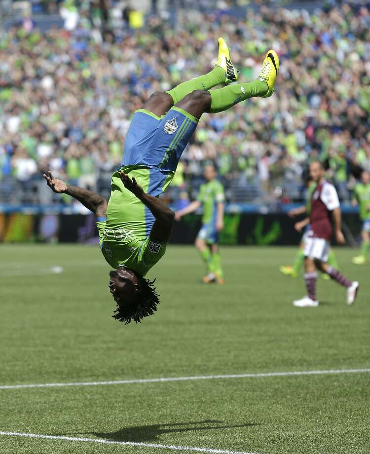 Seattle Sounders' Obafemi Martins does a backflip after he scored a goal against the Colorado Rapids, Saturday, April 26, 2014 in the second half of an MLS soccer match in Seattle. The Sounders beat the Rapids 4-1. (AP Photo/Ted S. Warren) Photo: Ted S. Warren, Associated Press