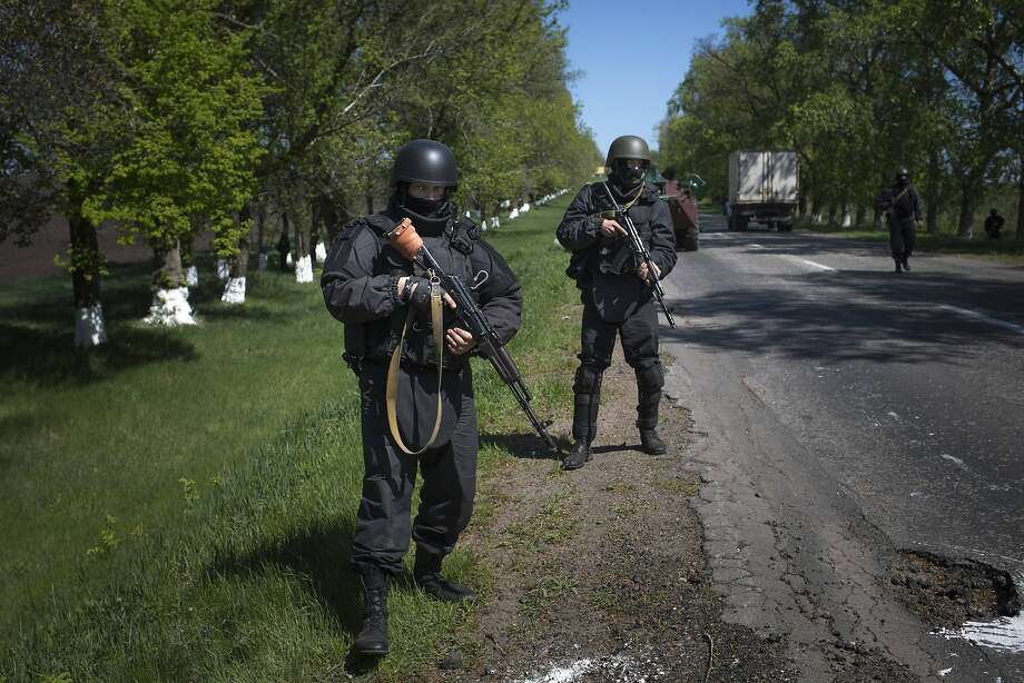 Ukrainian government troops patrol on a country road outside the town of Svyitohirsk near to Slovyansk, eastern Ukraine, Saturday, April 26, 2014. Ukrainian authorities are undertaking a security operation to liberate the nearby city of Slovyansk, which is currently controlled by an armed pro-Russian insurgency.(AP Photo/Alexander Zemlianichenko) Photo: Alexander Zemlianichenko, Associated Press