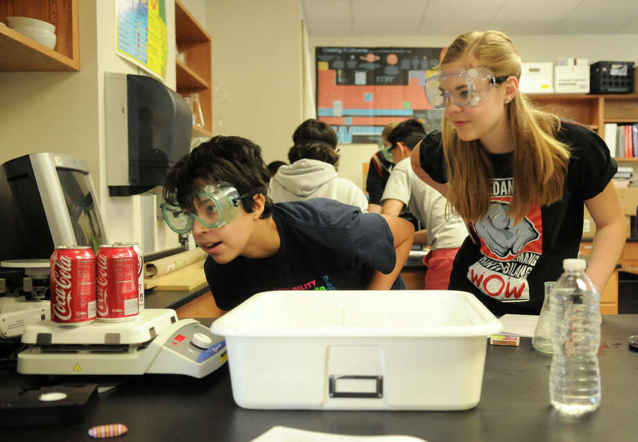 Conroe ISD - $972 millionEnrollment: 53,632Debt outstanding per student: $18,140Pictured: The Woodlands College Park High School Pre-AP Chemistry students Maya Vasquez, 15, left, and Annmarie Janning, 16, team up on a Demonstration of Gas Laws Lab. Photo: Jerry Baker, For The Chronicle