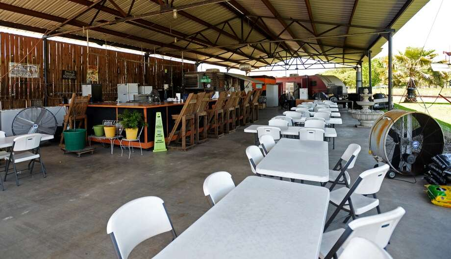 Pictured is the open air but covered seating area at Sneaky Pete's on Tuesday afternoon. Sneaky Pete's has been doling out burgers and loaded potatoes in Groves since 2009. The restaurant is open from Monday to Saturday, from 10 am to 6 pm, and delivers to local businesses from 10 am to 1pm. Photo taken Tuesday, 4/15/14 Jake Daniels/@JakeD_in_SETX