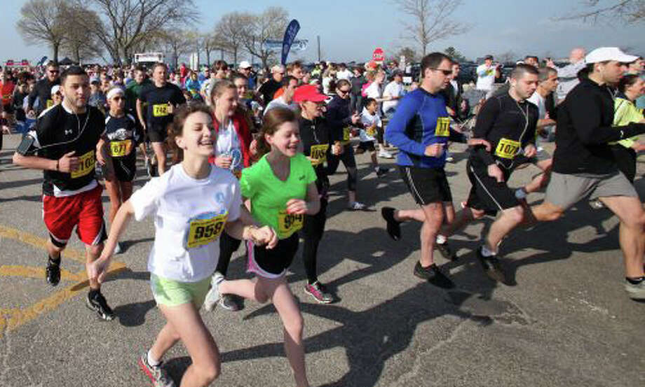 Several thousand participants are expected at today's 36th Minute Man Races sponsored by the Westport Young Women's League at Compo Beach. Here, a scene from last year's event. Photo: File Photo / Westport News