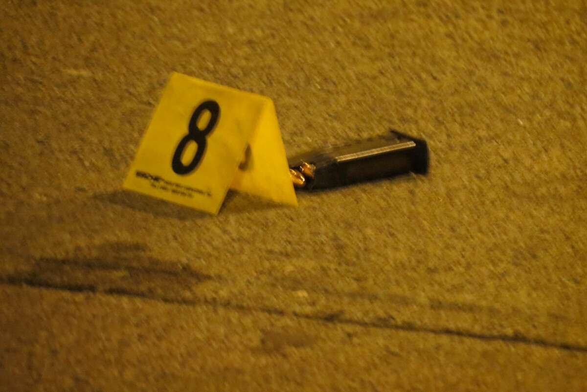 An evidence marker indicates where police found a clip after a gunman opened fire on a crowd of people early Sunday morning. Five people were shot but none of the injuries are life threatening, police said. (Tom Heffernan Sr. / Special to the Times Union)