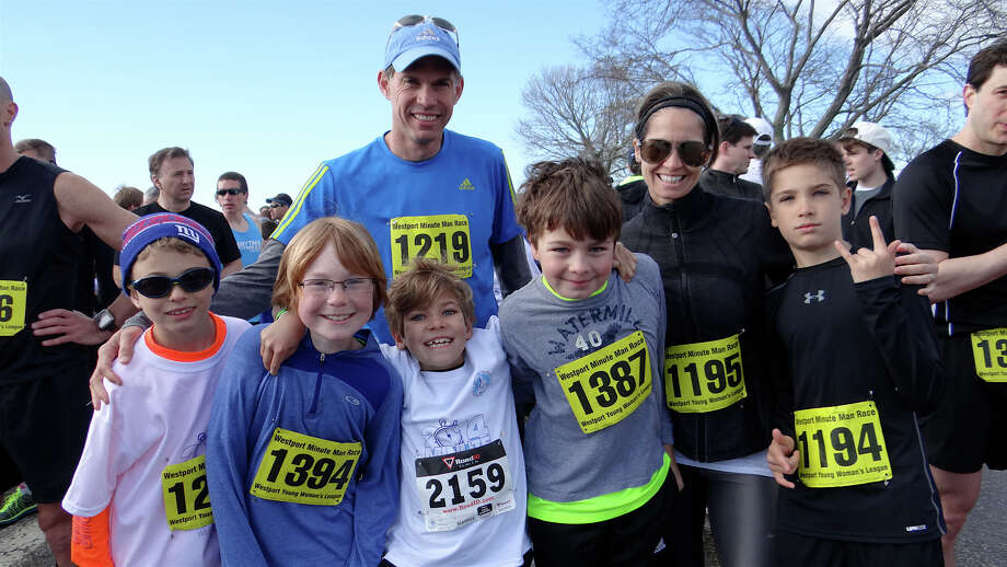 Westporters Alex St. Andre, 8; Liam Spellacy, 10; Jim St. Andre, Gavin Santoro, 8; Ben Bundy, 9, Chasity Santoro and Aiden Santoro, 9, at the Sunday morning Westport Young Women's League's Minute Man Race at Compo Beach. Photo: Mike Lauterborn / Westport News