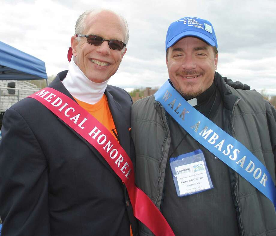 2014 medical honoree Richard Pope (left) with Father Jeff Couture (right), adult honoree for The 2014 Walk to Cure Arthritis. The fundraiser was held Sunday, April 27, 2014 at Immaculate High School. Were you SEEN? Photo: Wendy Mitchell