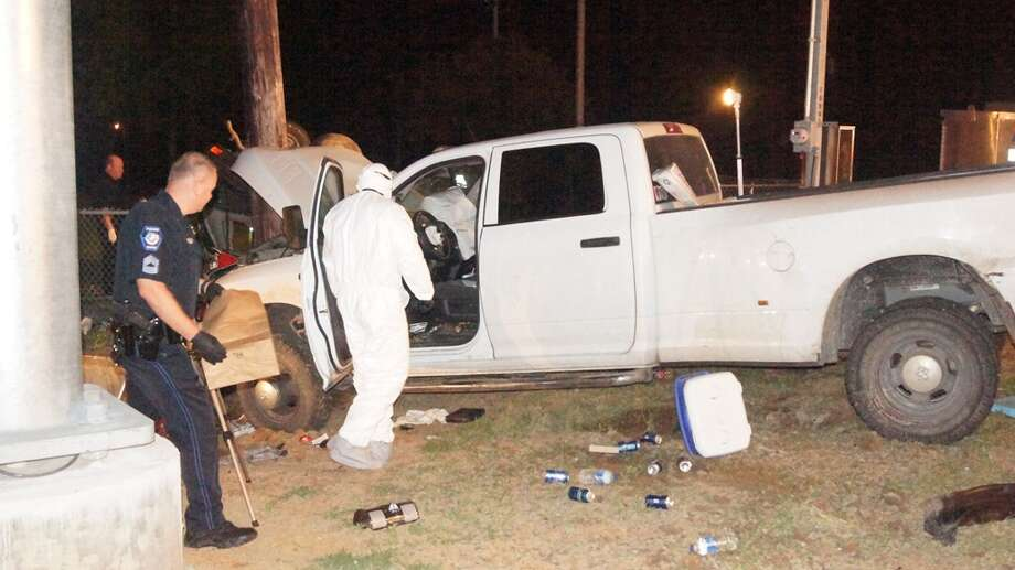 Photos detail how a Dodge pickup rear-ended a Mitsubishi SUV in a fatal wreck Saturday night on Texas 105 near April Sound. Reports say the pickup driver has been charged with intoxication manslaughter. Photo: Scott Engle/Montgomery County Police Reporter