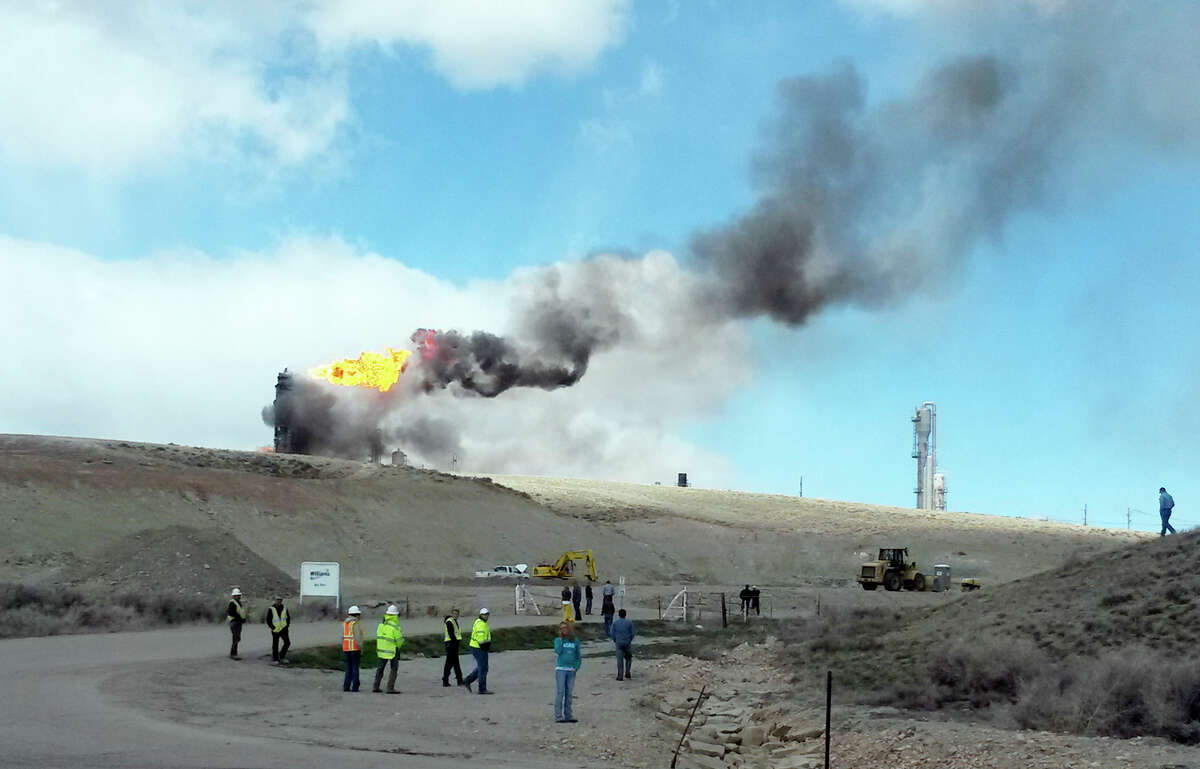 An explosion and fire at a natural gas processing facility and major national pipeline hub, Wednesday, April 23, 2014, in Opal, Wyo. Older oil and gas facilities are major emitters of methane into the atmosphere.