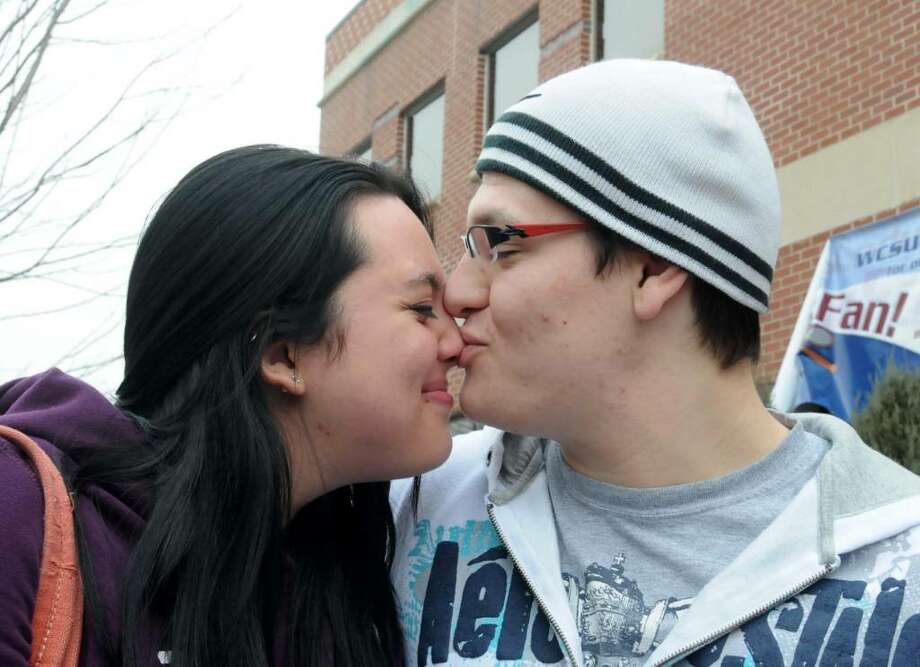 Alysha Cloutier, left, 19 of Danbury, and her boyfriend of almost a year, Mark Santaromita, 18, of Danbury spend time together after Cloutier is finished with her classes for the day on Tuesday, Feb. 2, 2010. Cloutier is a student at Western Connecticut State University in Danbury. Santaromita gives Cloutier a kiss. Photo: Lisa Weir / The News-Times