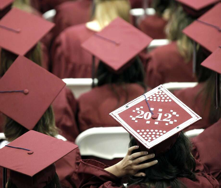 Graduates of Joplin High School in Joplin, Mo., listen to speakers at their commencement ceremony in May 2012. Photo: Charlie Riedel, Associated Press