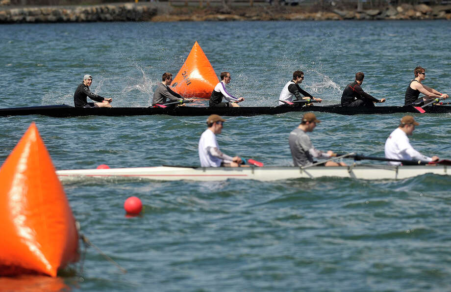 The teams representing Williams College, at top, and Brown University cross the finish line during the Alumni Sprints Regatta on Greenwich Cove in Greenwich, Conn., on Sunday, April 27, 2014. Photo: Jason Rearick / Stamford Advocate