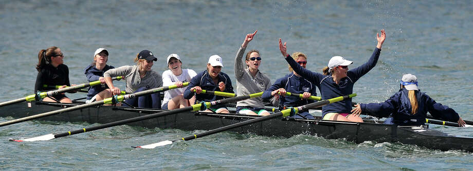 A woman's team representing Georgetown University celebrates after their finish during the Alumni Sprints Regatta on Greenwich Cove in Greenwich, Conn., on Sunday, April 27, 2014. Photo: Jason Rearick / Stamford Advocate
