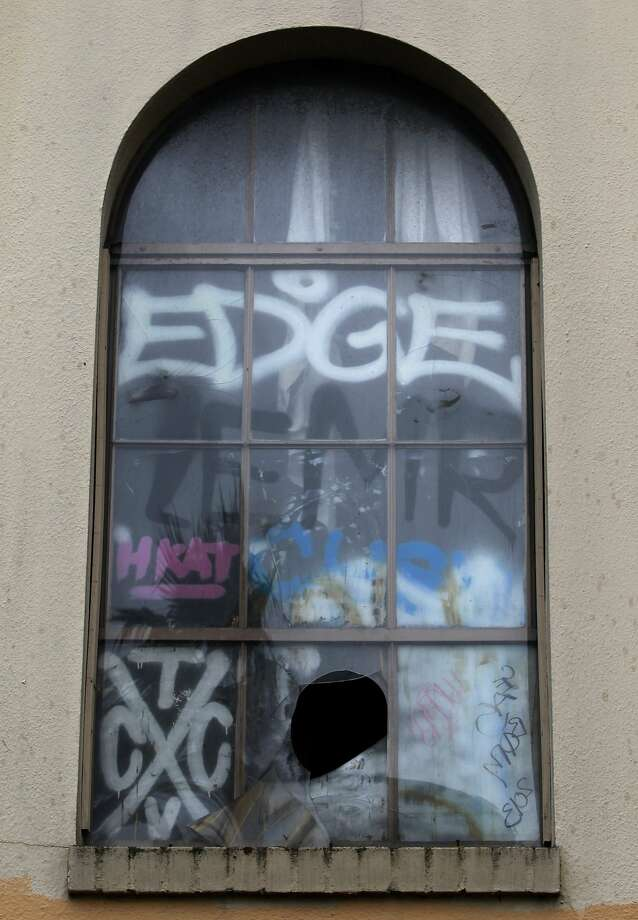 Graffiti covers the windows of the shuttered Schlage Lock factory in S.F. Photo: Paul Chinn, The Chronicle