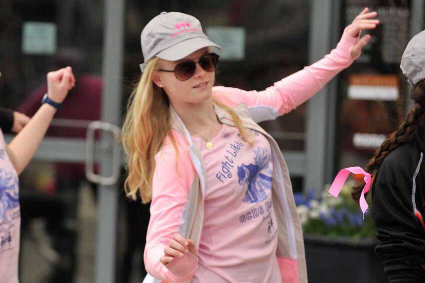 Courtney Smith dances to the DJ at the Breast Cancer Alliance annual Walk for Hope event in Greenwich, Conn., on Sunday, April 27, 2014.