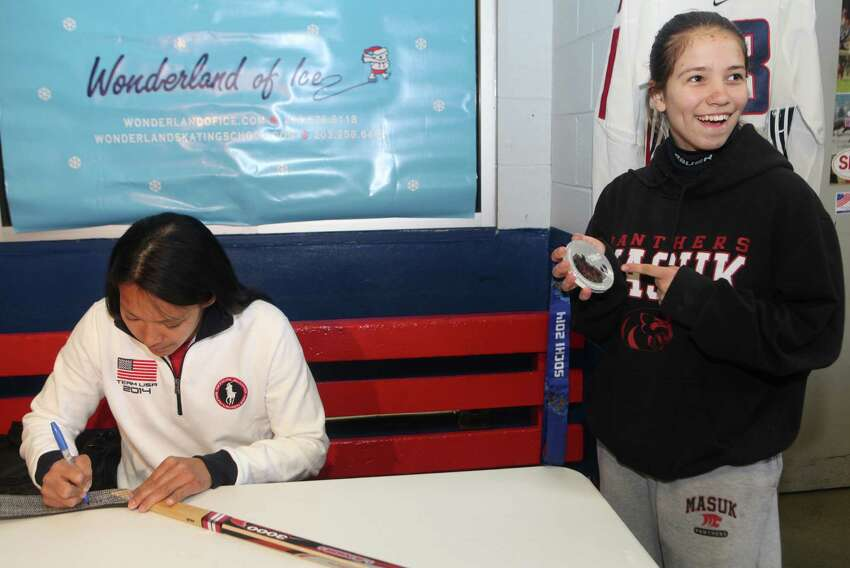 Olympic silver medalist Julie Chu meets and signs a stick for Michelle Vaidere-Silovs, 14, of Monroe, and other fans at the Bridgeport Wonderland of Ice on Sunday, April 27, 2014.