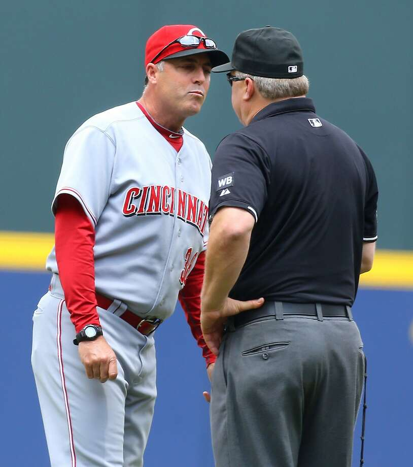 Cincinnati Reds manager Bryan Price is ejected from the game by second base umpire Bill Miller, after arguing a first base call following a review, in the first inning against the Atlanta Braves at Turner Field in Atlanta, Sunday, April 27, 2014. The Braves defeated the Reds in 10 innings, 1-0. (Curtis Compton/Atlanta Journal-Constitution/MCT) Photo: Curtis Compton, McClatchy-Tribune News Service