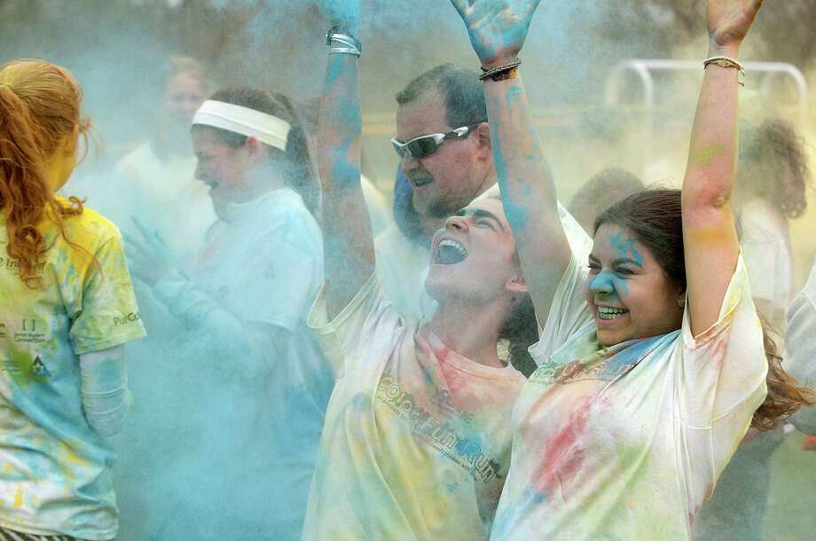 Scenes from the J-Serve's Color Fun Run at the Jewish Community Center in Stamford, Conn., on Sunday, April 27, 2014. The proceeds from the run benefit Sunrise Day Camp, a summer camp for children battling cancer. Photo: Jason Rearick / Stamford Advocate