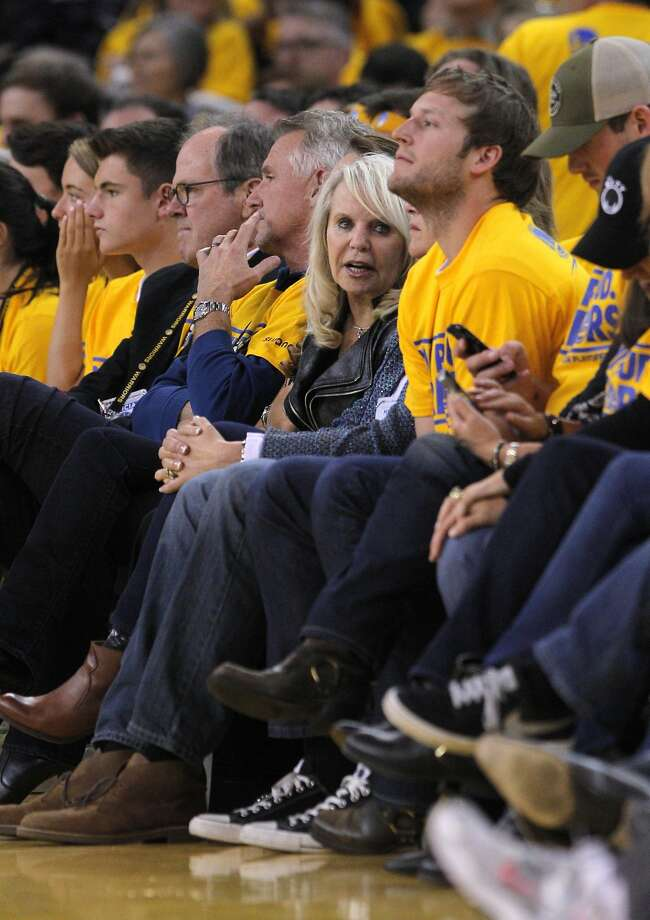 Shelly Sterling, center, estranged wife of Donald Sterling, owner of the Los Angeles Clippers, sits courtside during the second half as the Warriors defeated the Clippers in Game 4 on Sunday. Donald Sterling did not attend the game in the wake of a backlash to alleged racially insensitive remarks made to his girlfriend and published by website TMZ.com. The Golden State Warriors played the Los Angeles Clippers at Oracle Arena in Oakland, Calif., on Sunday, April 27, 2014, in Game 4 of the first-round playoff series. Photo: Carlos Avila Gonzalez, The Chronicle