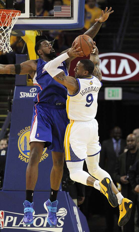 Warriors swingman Andre Iguodala, who scored 22 points, drives on the Clippers' DeAndre Jordan in the second half. Photo: Carlos Avila Gonzalez, The Chronicle