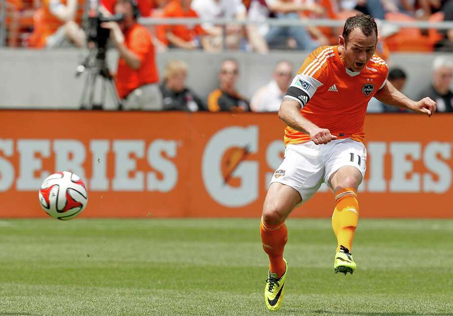 Houston Dynamo midfielder Brad Davis (11) shoots on goal against the Portland Timbers at BBVA Compass Stadium in Houston, Texas. Dynamo and Portland draw 1 to 1. Photo: Thomas B. Shea, For The Chronicle / © 2014 Thomas B. Shea
