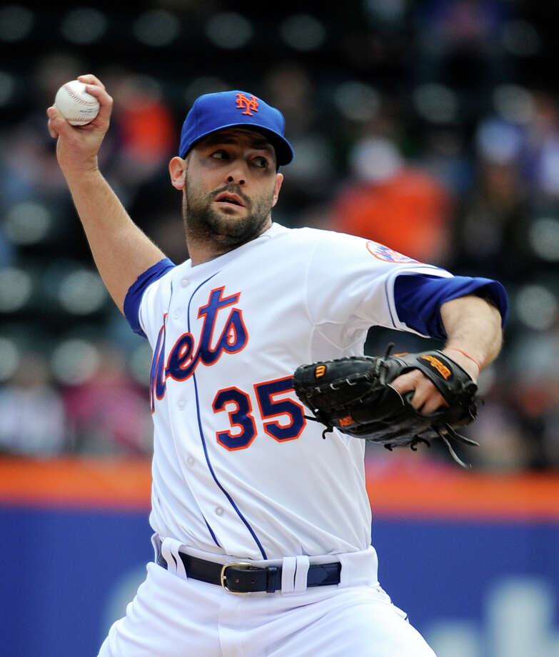 New York Mets starting pitcher Dillon Gee (35) throws against the Miami Marlins in the first inning of a baseball game at Citi Field on Sunday, April 27, 2014, in New York. (AP Photo/Kathy Kmonicek) ORG XMIT: NYM101 Photo: Kathy Kmonicek / FR170189 AP
