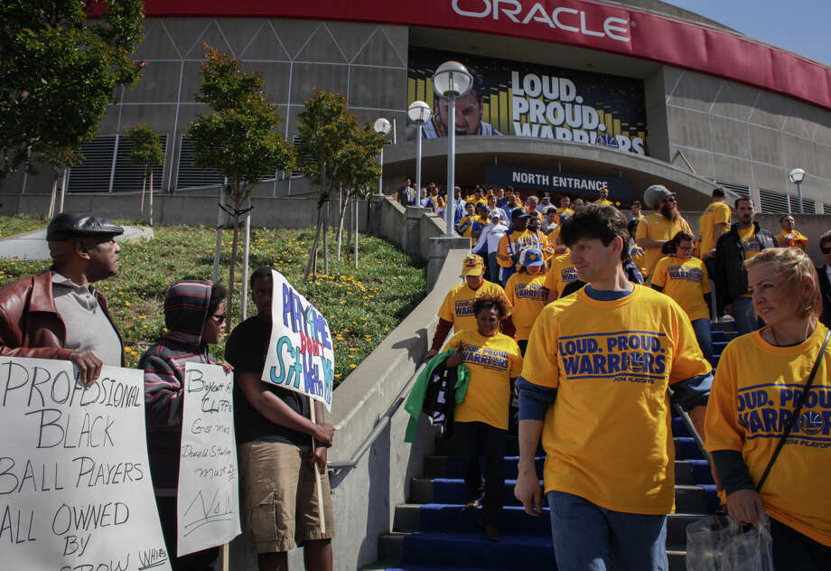 Fans leaving Game 4 are met by protests a day after reports of Clippers owner Donald Sterling's racist comments surfaced. Photo: Sam Wolson / Special To The Chronicle / ONLINE_YES