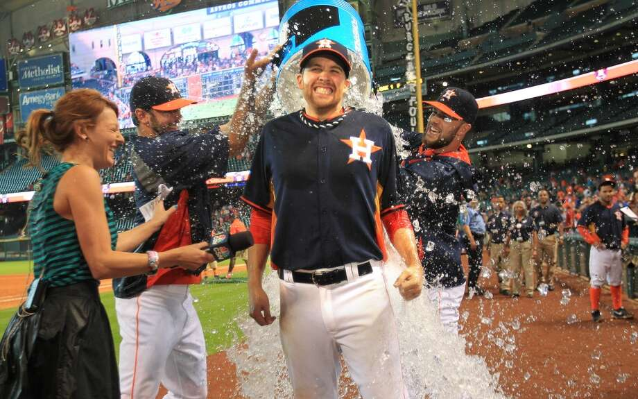 April 27 Astros 5, Athletics 1  Astros starting pitcher Collin McHugh is dunked by teammates during his TV interview After Sunday's 5-1 win over the A's. Photo: Mayra Beltran, Houston Chronicle