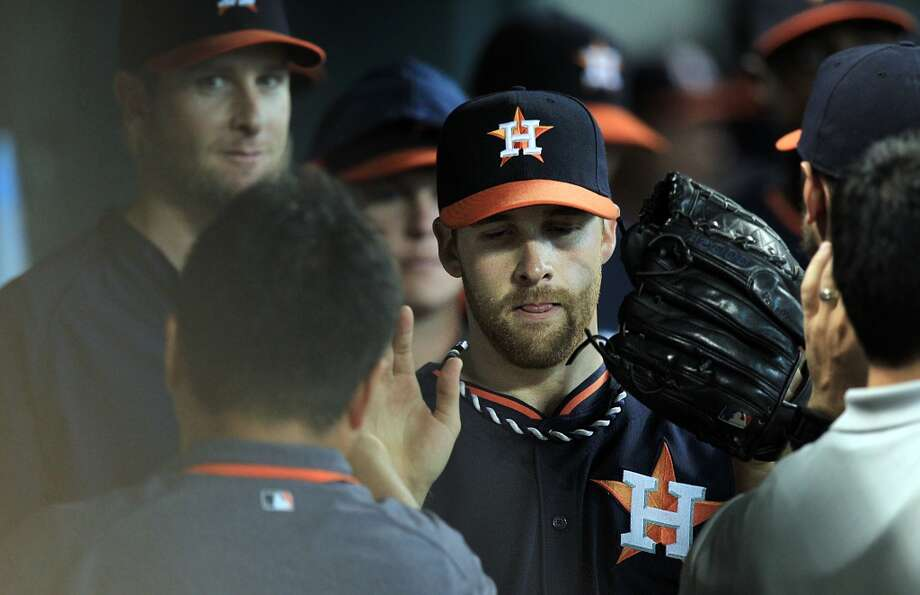Astros pitcher Collin McHugh is greeted in the dugout after Sunday's stellar start. Photo: Mayra Beltran, Houston Chronicle