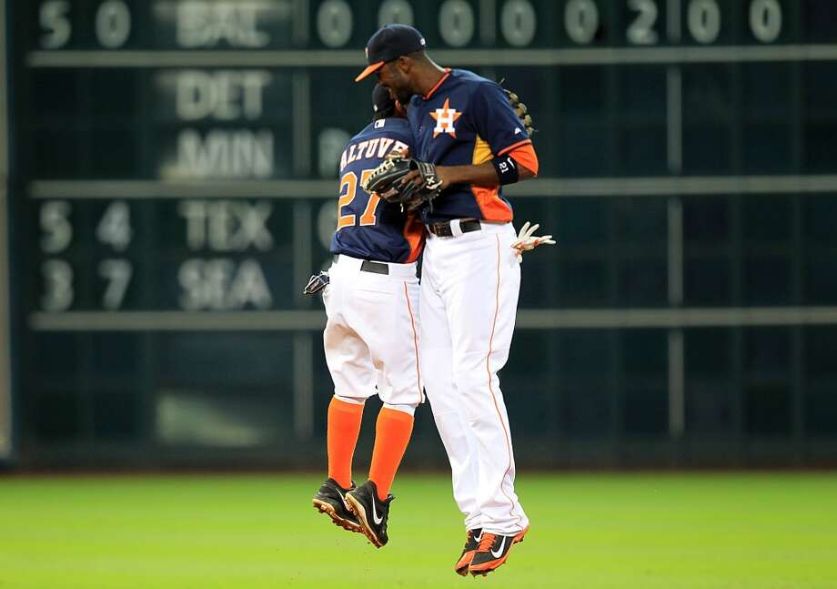 Jose Altuve, left, and Dexter Fowler celebrate Sunday's win over the A's. Photo: Mayra Beltran, Houston Chronicle