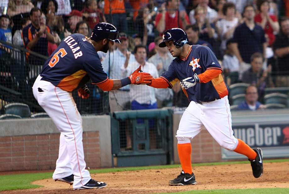 Shortstop Jonathan Villar, left, celebrates with Jose Altuve. Photo: Mayra Beltran, Houston Chronicle