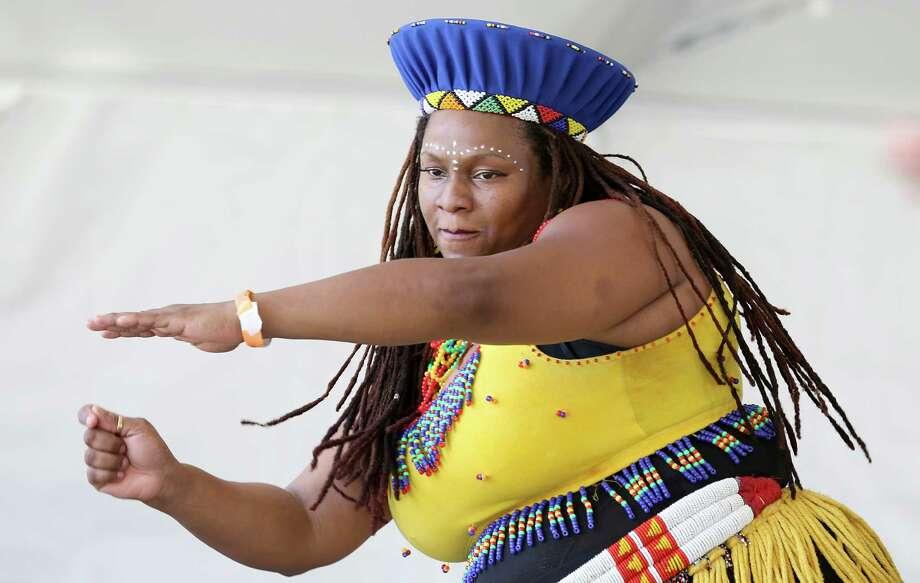 The KoumanKe'le' African Dance and Drum Ensemble perform at the International Festival- Australia in Houston, Texas. Photo: Thomas B. Shea, For The Chronicle / © 2014 Thomas B. Shea