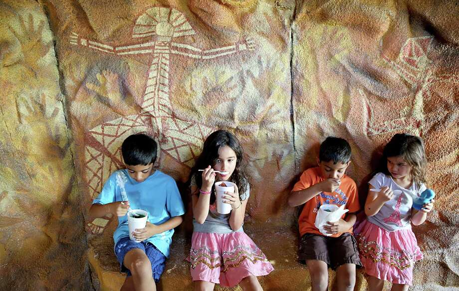 From left to right, Iyush Kothari, age 9, Ellie Mehta, age 7, Anuj Kothari, age 7 and Sophie Mehta, age 5 all from Houston, enjoy a water ice inside the Australian Cave exhibit at the International Festival- Australia in Houston, Texas. Photo: Thomas B. Shea, For The Chronicle / © 2014 Thomas B. Shea