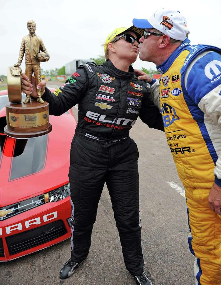 Erica Enders-Stevens, left, and Allen Johnson show that fierce competitors can remain friends after she won the Pro Stock final Sunday. Photo: Eric Christian Smith, Freelance